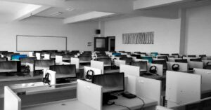 Empty call center cubicles with computers, headsets, and phones ready for CMS call center monitoring